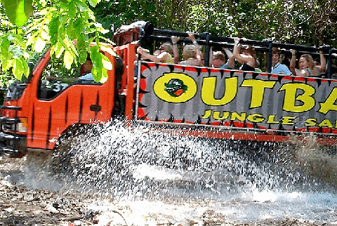 Tourist in the Outback truck crossing a river Punta Cana