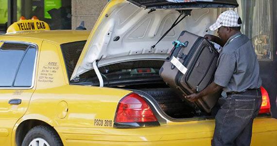 Santo-Domingo-Taxi-Driver-Loading-Suitecases